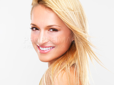 Buy stock photo Portrait of a beautiful blonde woman with flawless skin smiling at you, isolated on white