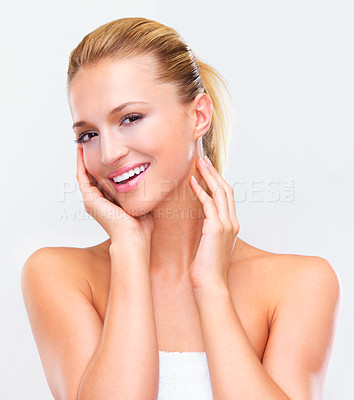 Buy stock photo Head and shoulders isolated portrait of a gorgeous blonde woman with a naturally radiant skin smiling at you