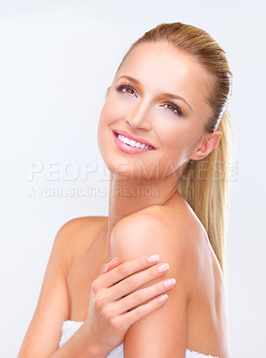 Buy stock photo Naturally beautiful blonde woman with flawless skin gazing upward dreamily, isolated on white