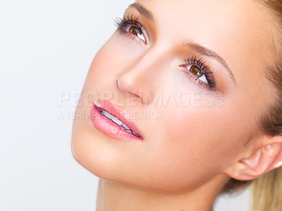 Buy stock photo Cropped closeup of a naturally beautiful woman with flawless skin gazing away dreamily, isolated on white