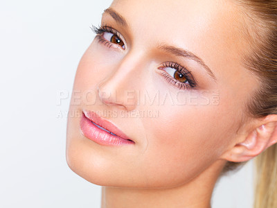 Buy stock photo Cropped closeup of a naturally beautiful woman with flawless skin gazing at you, isolated on white