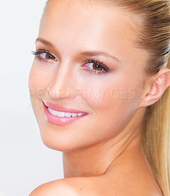 Buy stock photo Cropped closeup of a naturally beautiful woman with flawless skin smiling at you, isolated on white