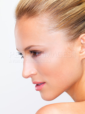 Buy stock photo Closeup profile of a radiantly beautiful woman looking away thoughtfully, isolated on white