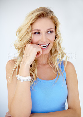 Buy stock photo Pretty young woman biting her finger - Isolated on white