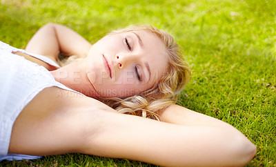Buy stock photo Young woman taking some time to have a cat nap outdoors in her garden