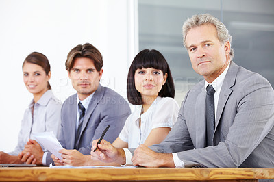 Buy stock photo Portrait of a team of businesspeople looking determined