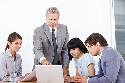 Buy stock photo A business manager leading a strategy meeting at the office