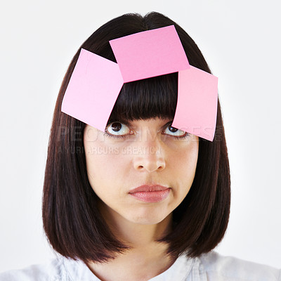 Buy stock photo Conceptual image of an overworked businesswoman struggling with the jumble of ideas on her mind