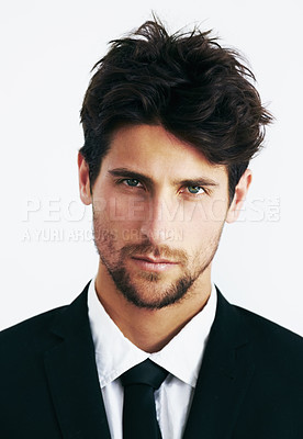 Buy stock photo Closeup portrait of a sexy man dressed in a black suit and tie with a smouldering look on his face
