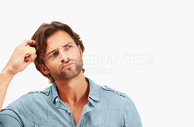 Buy stock photo A handsome male scratching his head with his finger thinking - isolated on white - Copyspace