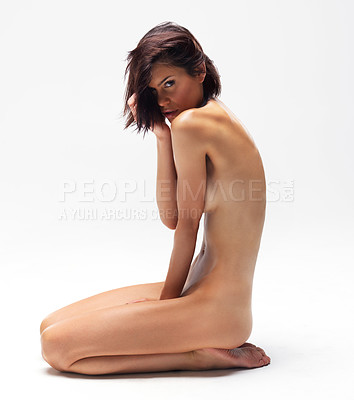 Buy stock photo Attractive nude woman kneeling while isolated on white