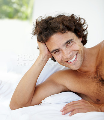 Buy stock photo Portrait of a handsome young man lying in bed at home
