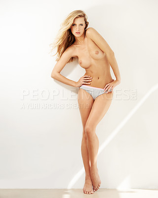 Buy stock photo Portrait of a beautiful young topless woman posing in her underwear