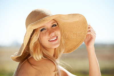 Buy stock photo Portrait of a beautiful young woman enjoying a sunny day outside