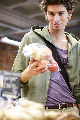 Buy stock photo A young man with apples in hand