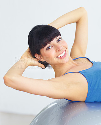 Buy stock photo Fit young woman doing sit-ups on an exercise ball
