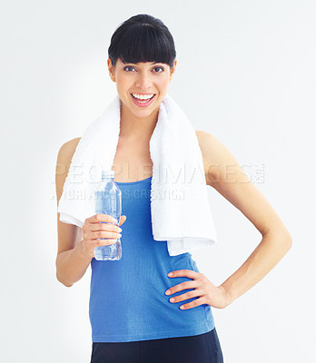 Buy stock photo Cropped image of a young woman holding a water bottle after a workout