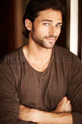 Buy stock photo Portrait of a handsome young man standing with his arms folded