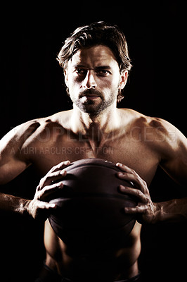Buy stock photo Portrait of a handsome muscular young man holding a basketball
