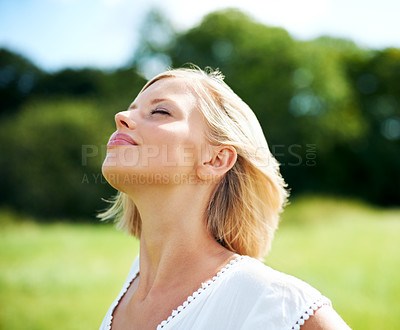 Buy stock photo Gorgeous young woman savoring the breeze outdoors