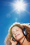 Closeup of cute young girl listening to music with headphones