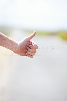 Buy stock photo Cropped image of a hitchiker's hand - copyspace