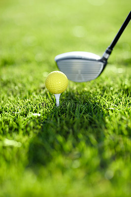 Buy stock photo A golf club ready to tee-off with a yellow ball on a golf course