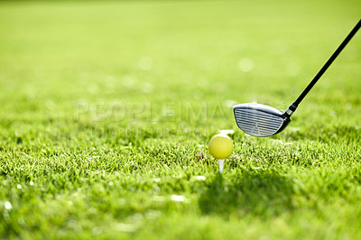Buy stock photo A golf club about to tee-off with a yellow ball on a golf course