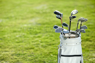 Buy stock photo A golf bag on the golf course