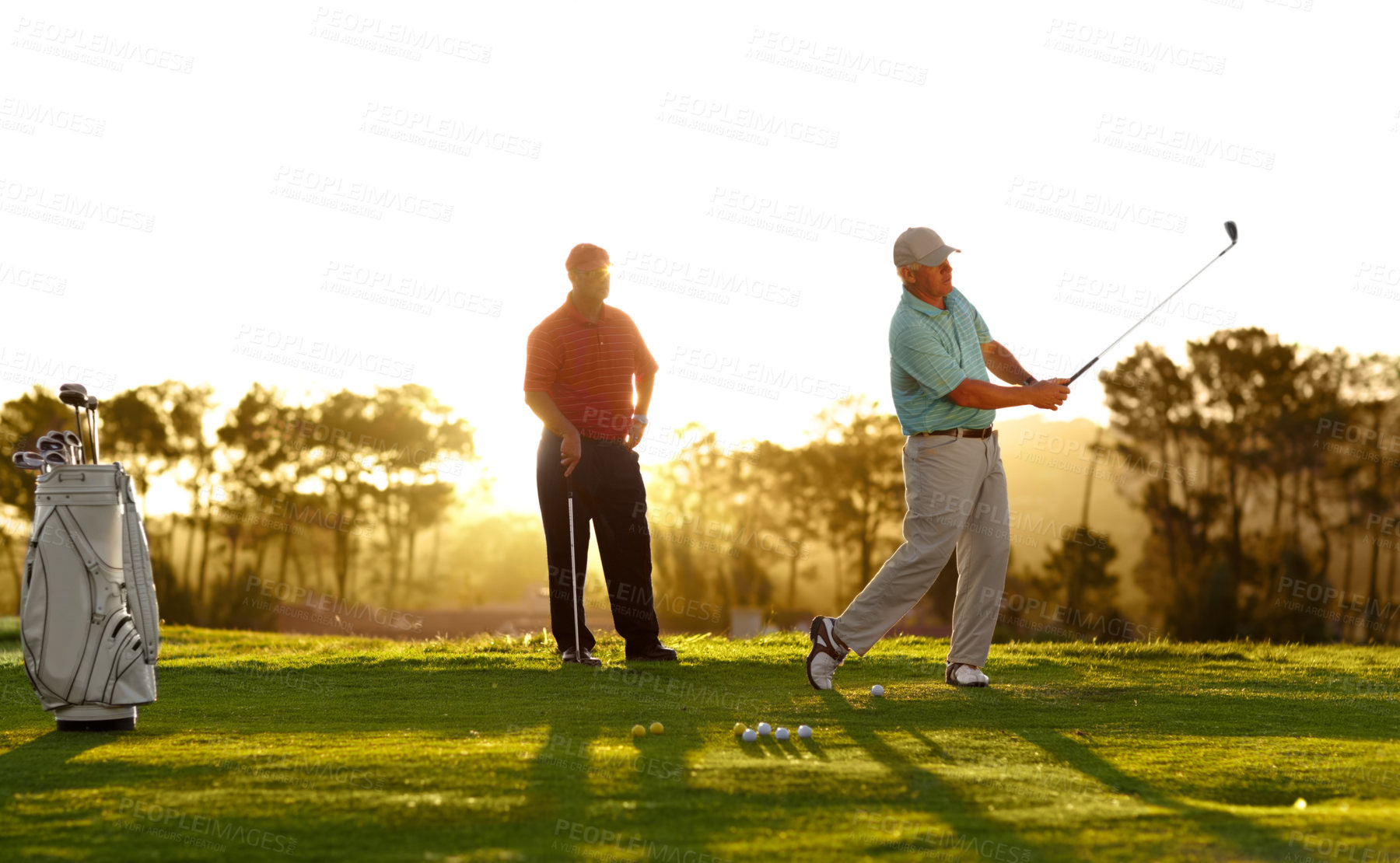 Buy stock photo Two male friends out on the golf course together
