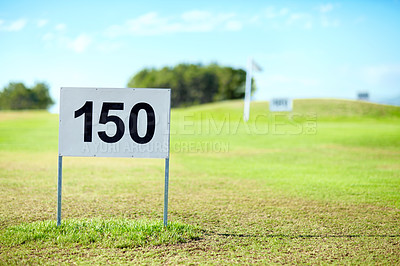 Buy stock photo Sign marking the 150 meter mark on a hole at the golf course