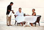 Mature couple having dinner at the beach