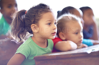 Buy stock photo Cute little preschoolers sitting in a classroom together