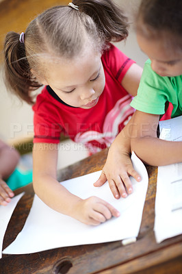 Buy stock photo Sweet little preschoolers sitting in a classroom and working together