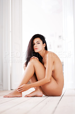Buy stock photo Portrait of a gorgeous nude woman sitting on a wooden floor