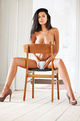Buy stock photo Portrait of a sexy nude young woman sitting on a chair while holding a coffee mug