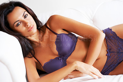 Buy stock photo Portrait of a sexy young woman in lingerie lying on a couch
