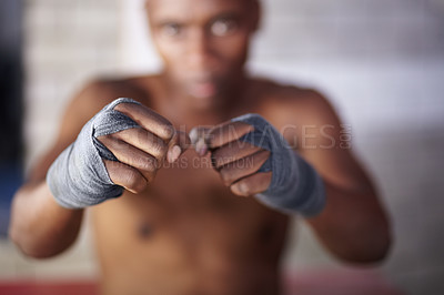 Buy stock photo Portrait of a young man standing in a fighting stance