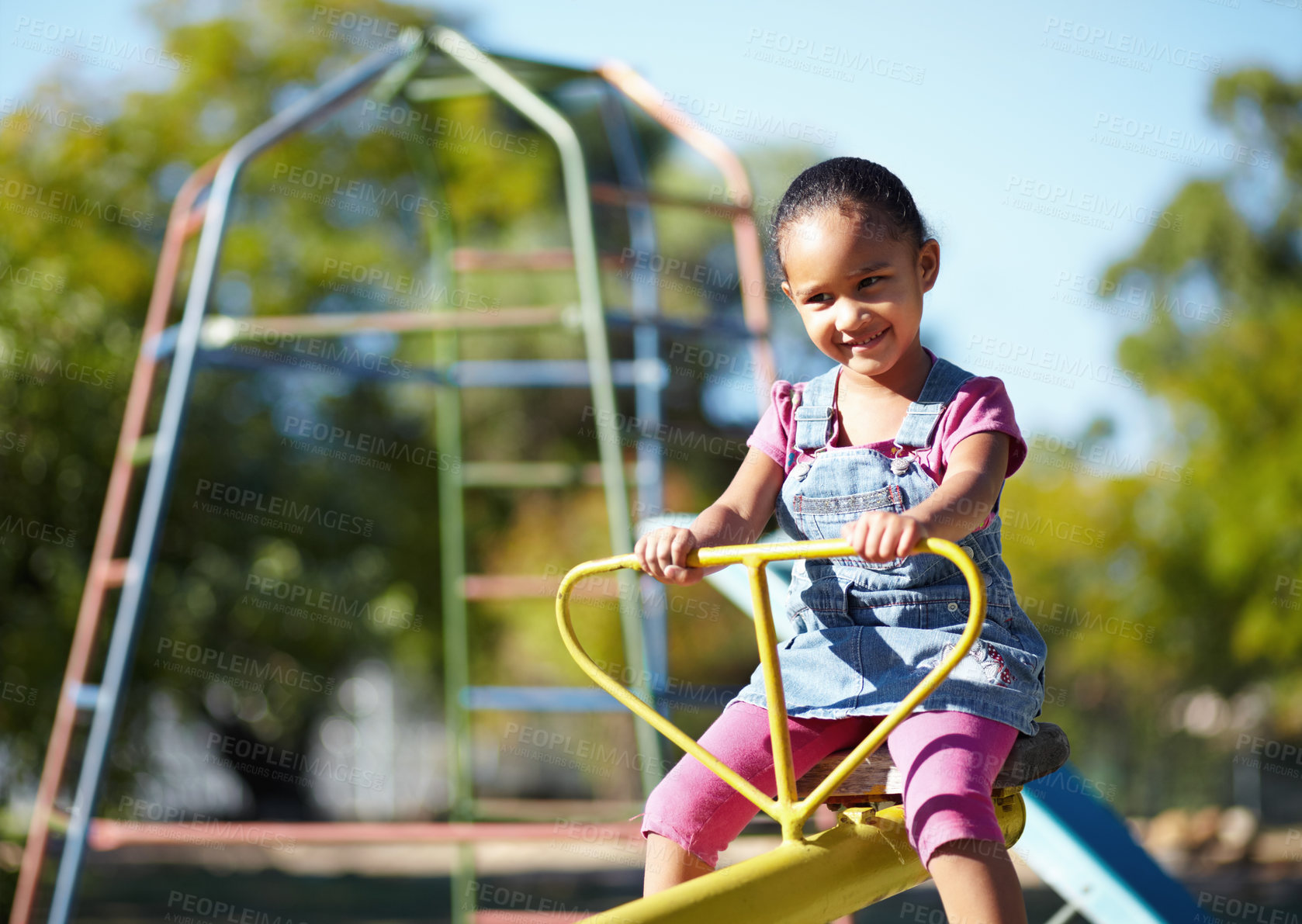 Buy stock photo Little girl on a see-saw with copyspace