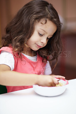 Buy stock photo Pre-school girl eating something in a bowl