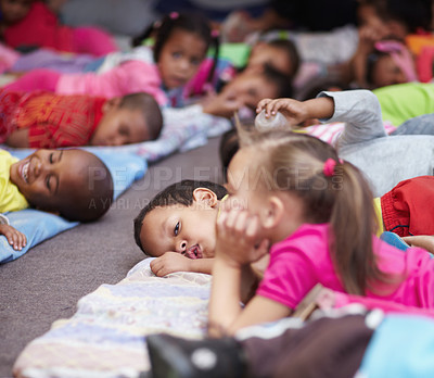 Buy stock photo Preschool children all lying down and getting ready for bed