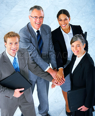 Buy stock photo Handshake and teamwork. A group of business people making a pile of hands in a light and modern office setting