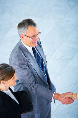 Buy stock photo Handshake and teamwork. Two businessmen shaking hands in a light and modern office.