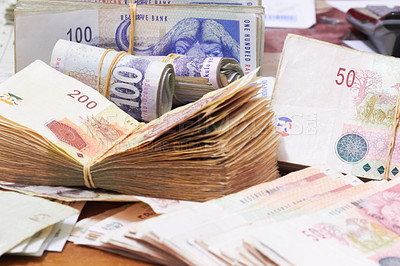 Buy stock photo Large piles of money and loose bills on the table