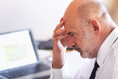 Buy stock photo Shot of a mature businessman sitting with his head in his hand