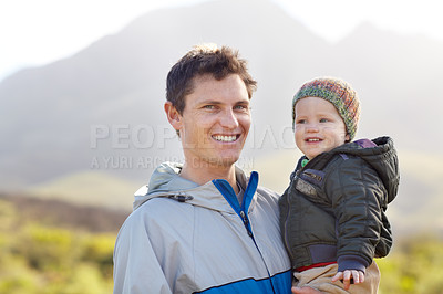 Buy stock photo Portrait of a young father with his little boy while on a hiking trip
