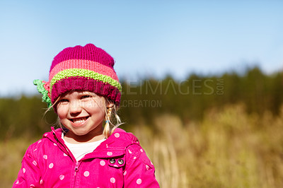 Buy stock photo Portrait of a cute little girl outdoors