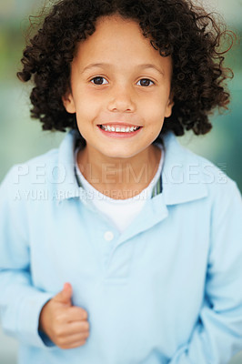 Buy stock photo Portrait of a cute young boy showing you thumbs up and looking positive