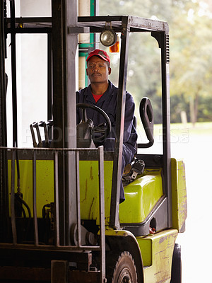 Buy stock photo A worker operating a forklift indoors