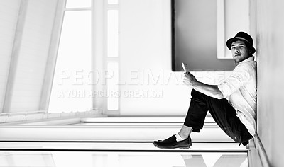 Buy stock photo A formally dressed man appears to be sitting on a window while leaning against the floor - perspective